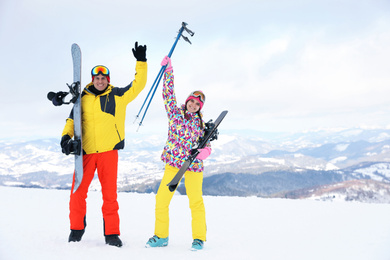 Lovely couple with equipment at ski resort. Winter vacation