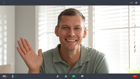 Man communicating with coworkers from home using video chat, view through camera