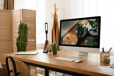 Modern workplace with computer in room. Interior design