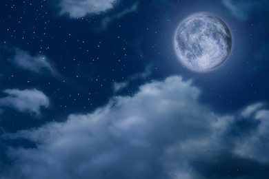 Beautiful night sky with full moon and clouds