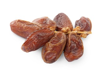 Sweet dates on branch against white background. Dried fruit as healthy snack
