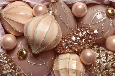 Many beautiful Christmas tree baubles as background, closeup