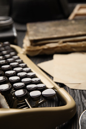 Typewriter on black wooden table, closeup. Detective's workplace