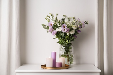 Bouquet of beautiful Eustoma flowers on table in room