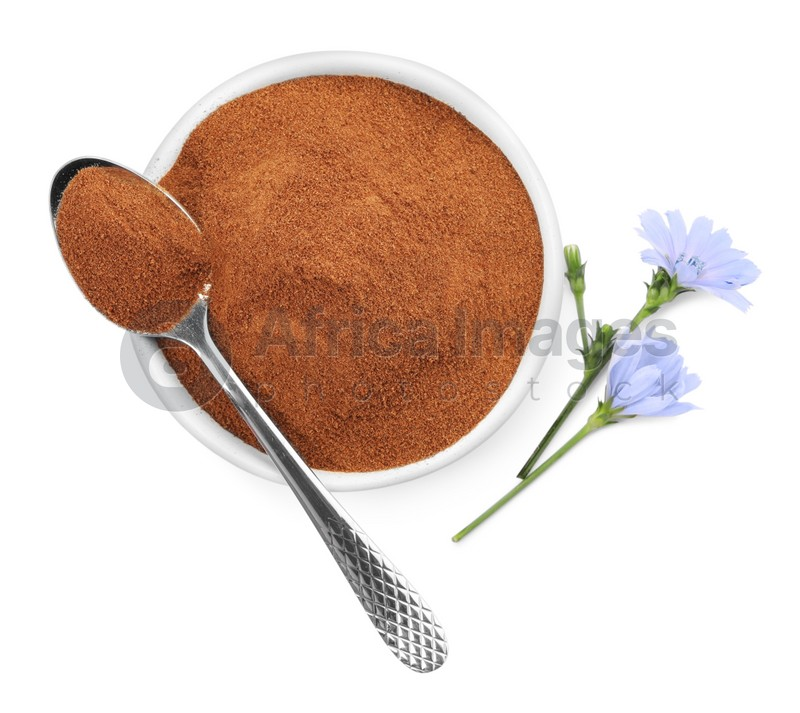 Plate and spoon of chicory powder with flowers on white background, top view
