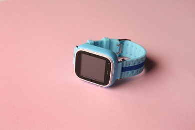 Modern trendy smart watch for kids on pink background