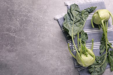 Whole ripe kohlrabi plants on grey table, flat lay. Space for text