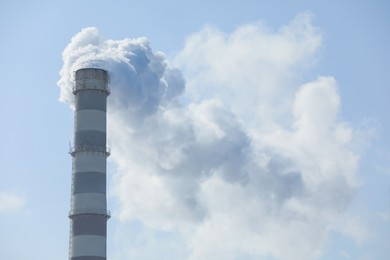 Polluting air with smoke from industrial chimney outdoors. CO2 emissions