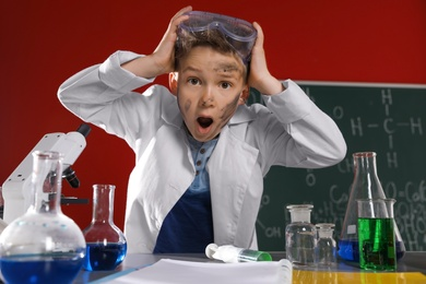 Emotional child in laboratory after explosion. Dangerous experiment
