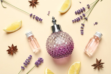 Flat lay composition with elegant perfume on beige background