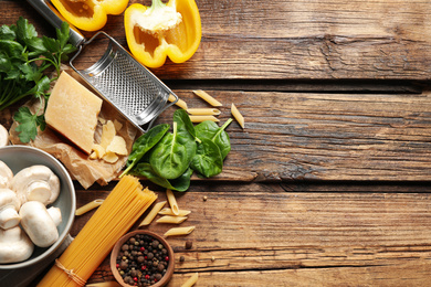 Flat lay composition with fresh products on wooden table, space for text. Healthy cooking