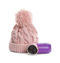 Modern fabric shaver and woolen hat on white background