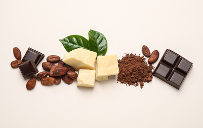 Flat lay composition with organic cocoa butter on beige background
