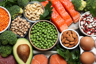 Products rich in protein as background, flat lay