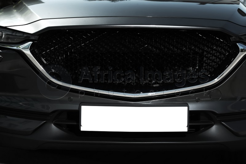 Car with vehicle registration plate, closeup. Mockup for design
