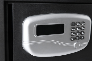 Open black steel safe with electronic lock, closeup