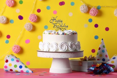 Beautiful birthday cake and decor on pink table