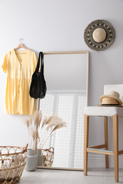 Room interior with mirror and stylish women's accessories. Design elements