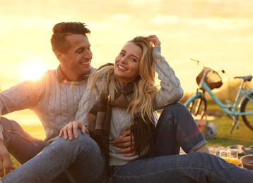 Happy young couple spending time together on picnic outdoors