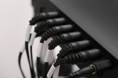 Modern electronic drum module with cables, closeup. Musical instrument