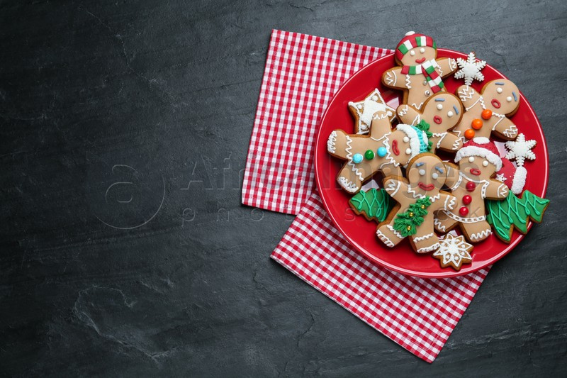 Delicious Christmas cookies on black table, top view. Space for text