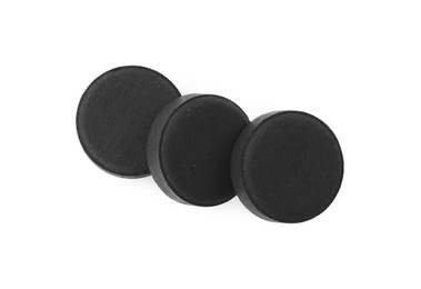 Activated charcoal pills on white background, top view. Potent sorbent