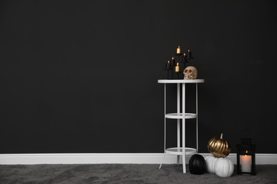 Halloween decor in room, space for text. Idea for festive interior