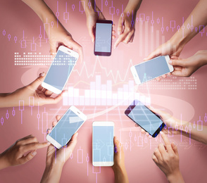 Financial technology and mobile communication concept. People working online using their smartphones, top view