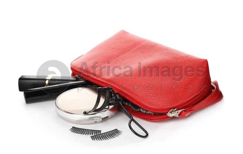 Cosmetic bag with eyelash curler and makeup products on white background