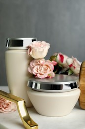 Hair care cosmetic products and beautiful flowers on tray