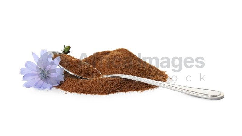 Spoon, chicory powder and flower on white background