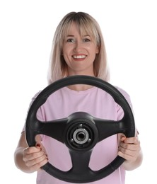 Happy woman with steering wheel on white background