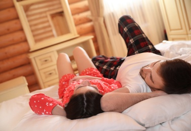 Couple lying in bed at home. Lazy morning