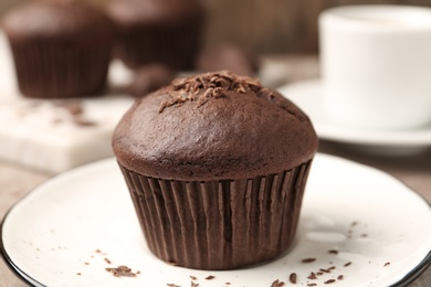 Delicious cupcake with chocolate crumbles on plate, closeup