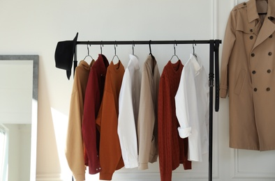 Rack with stylish clothes indoors. Interior design