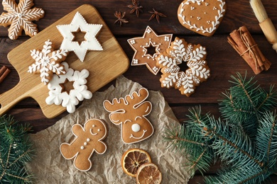 Flat lay composition with delicious homemade Christmas cookies on wooden table