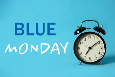 Alarm clock and text Blue Monday on color background