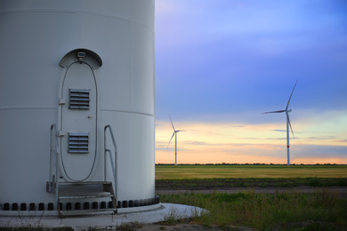 Entrance to wind turbine power generator outdoors in evening. Alternative energy source