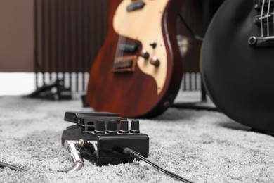 Electric guitar pedal at recording studio. Music band practice
