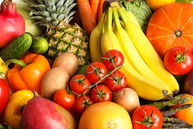 Assortment of fresh organic fruits and vegetables as background, closeup