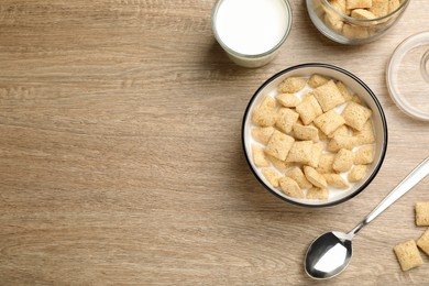 Tasty corn pads with milk served on wooden table, flat lay. Space for text