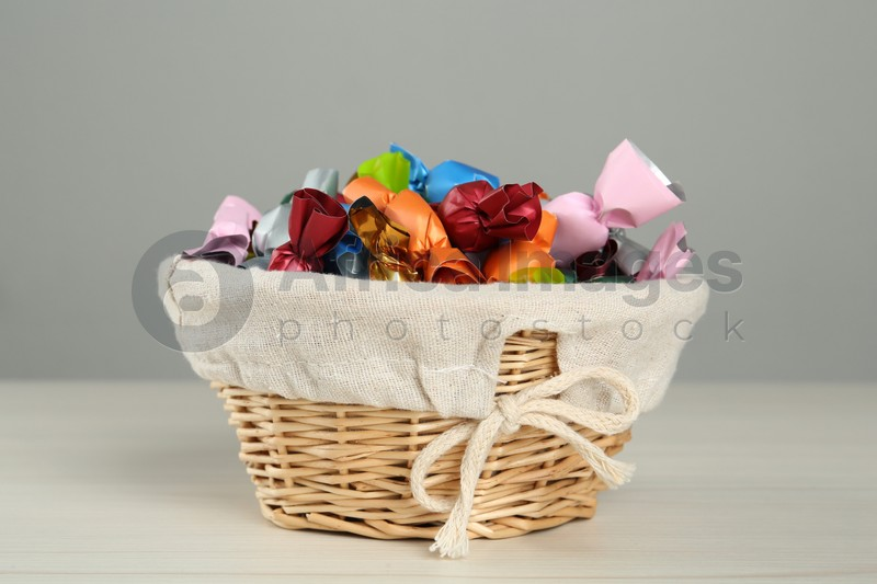Candies in colorful wrappers on light table