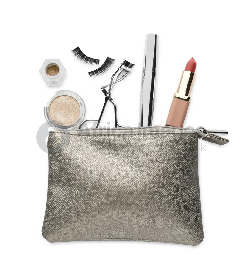 Cosmetic bag with eyelash curler and makeup products on white background, top view