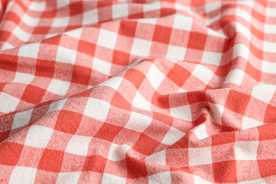 Texture of red checkered fabric as background, closeup