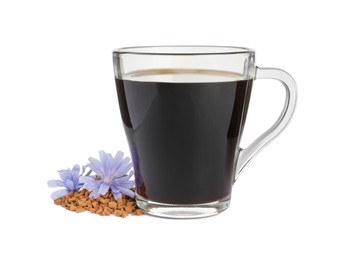 Glass cup of delicious chicory drink, granules and flowers on white background