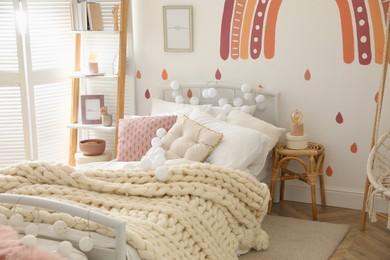 Stylish child's room interior with comfortable bed