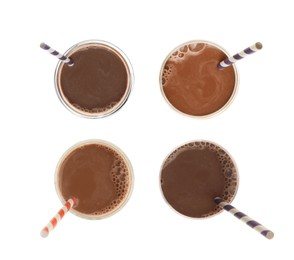 Set with delicious chocolate milk on white background, top view