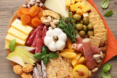 Different tasty appetizers on wooden table, top view