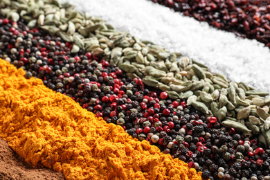 Many different spices as background, closeup view