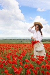 Woman with handbag and poppy flowers in beautiful field